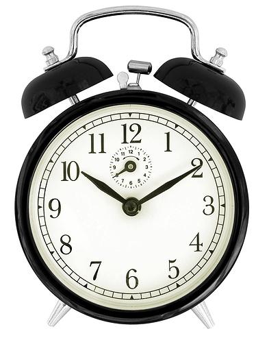 Black_windup_alarm_clock_face
